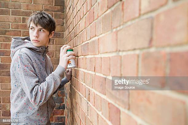 Boy doing graffiti