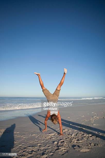 Boy doing handstand