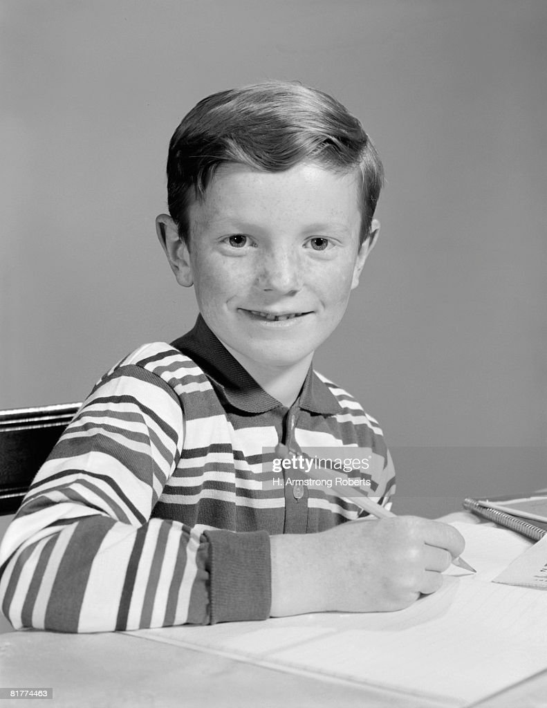 Boy doing homework, portrait. : Stock Photo