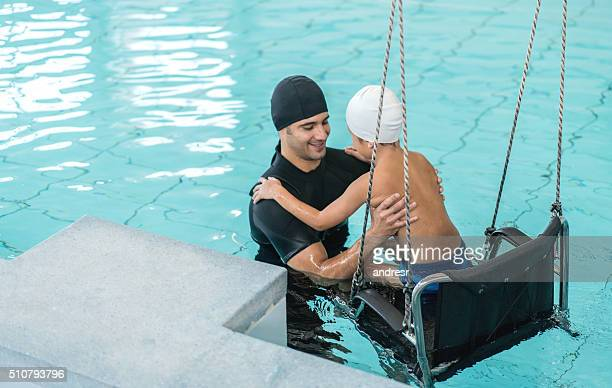 Boy doing physical therapy in the water