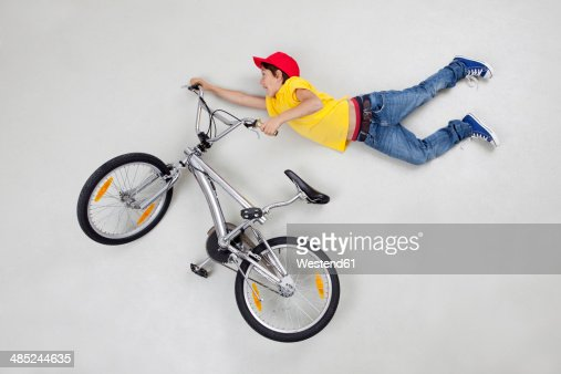 Boy doing stunt on bicycle