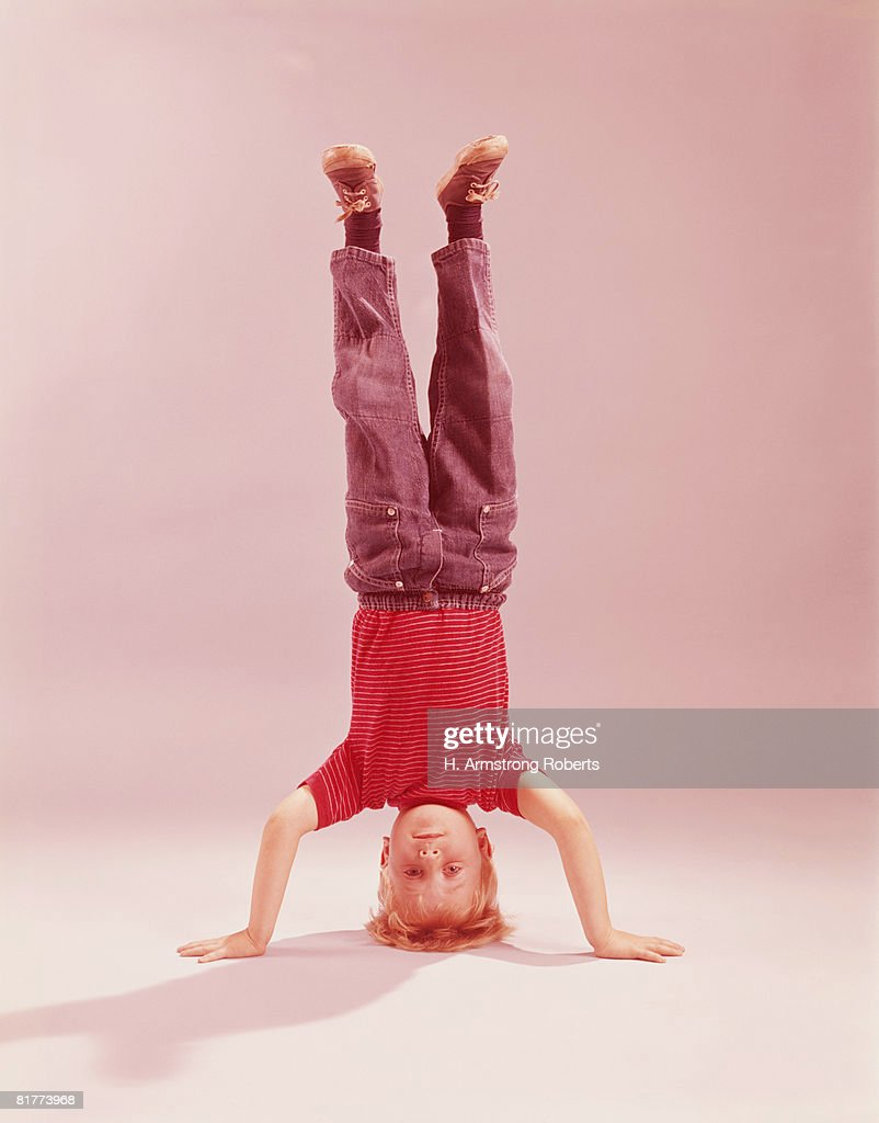 Boy doing three point headstand. (Photo by H. Armstrong Roberts/Retrofile/Getty Images) : Stock Photo