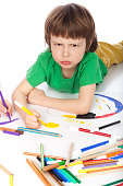 Image of boy doodling, on white background