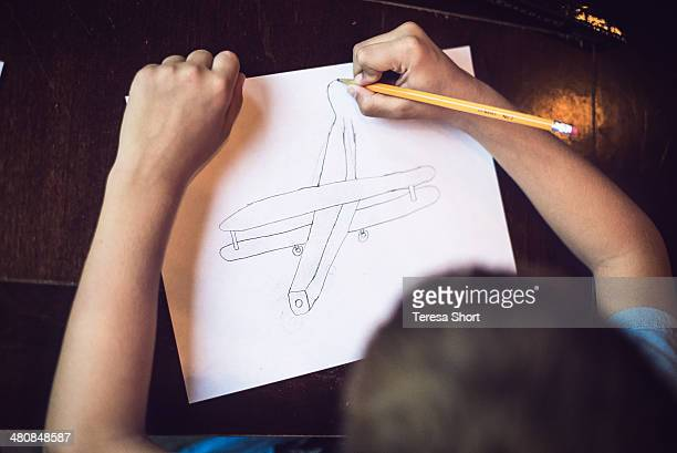 Boy Drawing Airplane
