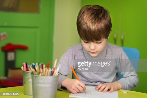 Boy Drawing In His Room Stock Photo Getty Images