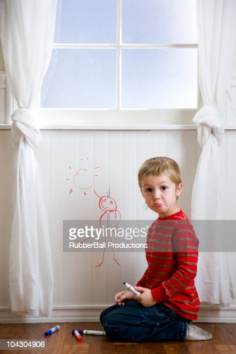 boy drawing on the wall : Stock Photo