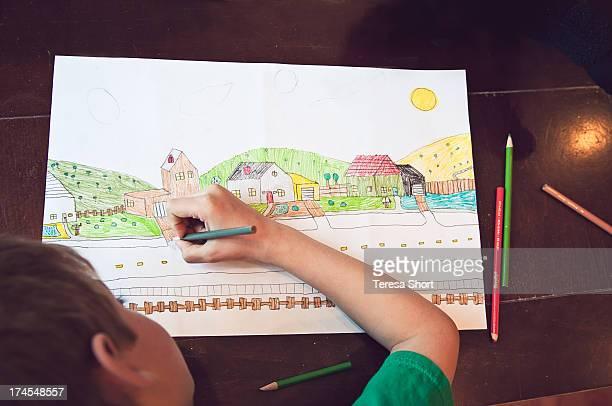 Boy Drawing Picture of Houses