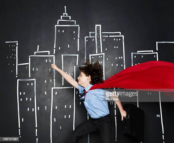 Boy dressed as a business superhero