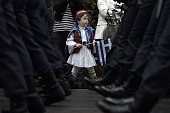 TOPSHOT A boy dressed as a Greek Presidental Guard watches a military parade on March 25 2016 in central Athens during the anniversary of the Greek...
