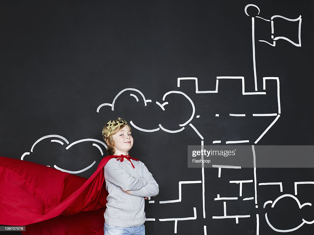 Boy dressed as a king outside his castle : Stock Photo