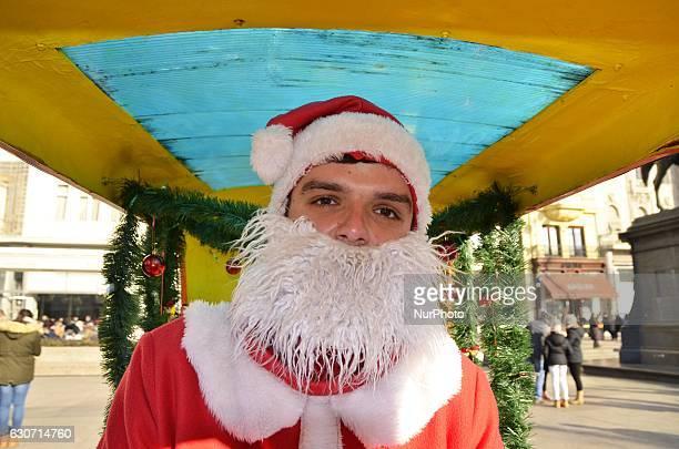 Boy dressed as a Santa Claus in Zagreb Croatia on 31 Dec 2016