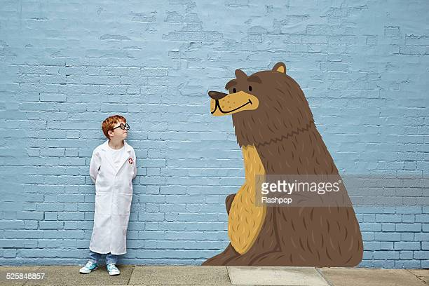 Boy dressed as a vet with cartoon bear
