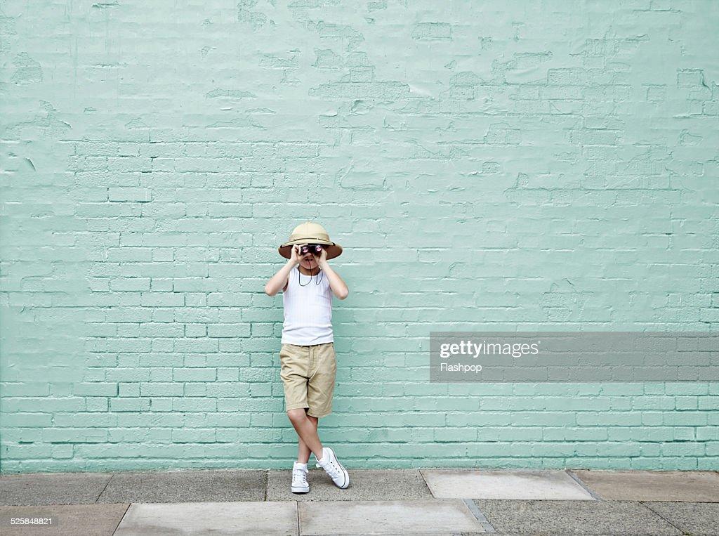 boy dressed as an adventurer with binoculars