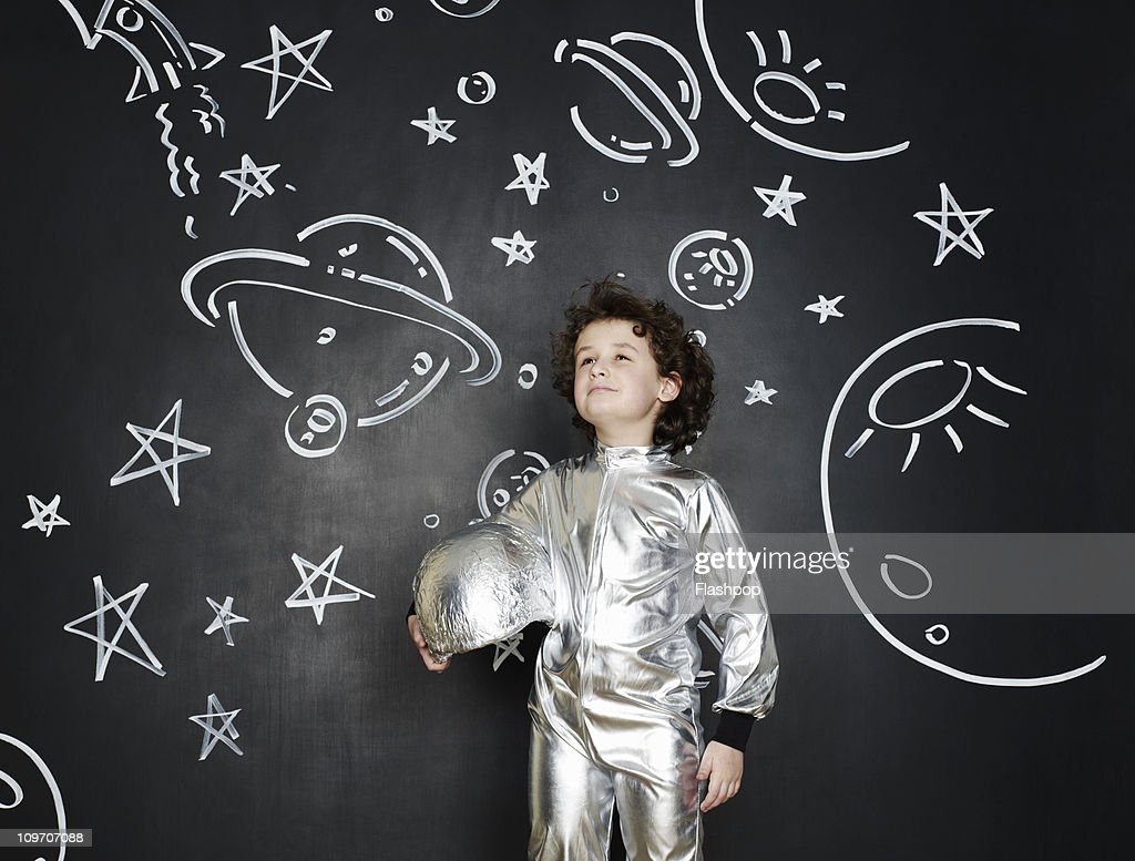Boy dressed as an astronaut : Stock Photo