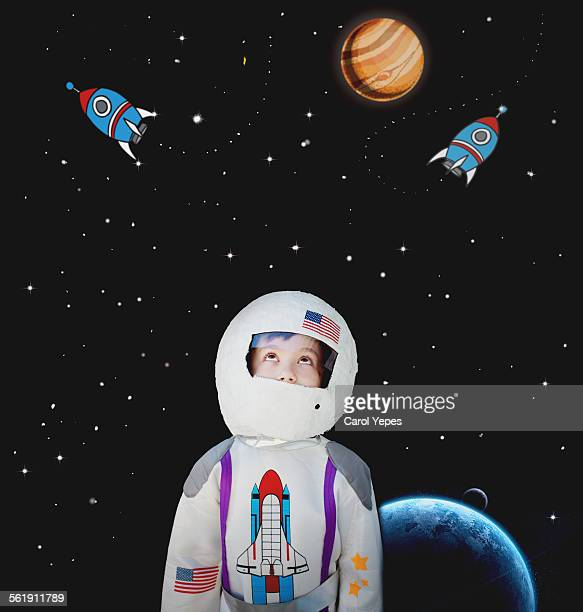 Boy dressed as astronaut.Cartoon in background