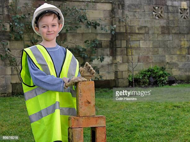 Boy dressed as builder