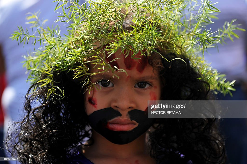 A boy dressed as Christ participates in the Via Crucis procession on Good Friday, as part of Holy Week activities in Managua, on March 29, 2013. AFP PHOTO/Hector RETAMAL