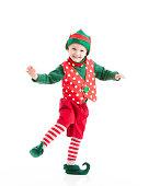 * Motion Blur. A happy, joyful, smiling boy, dressed as a Christmas elf, dances a gleeful jig.