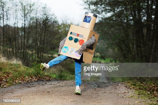 Boy dressed as robot outdoors