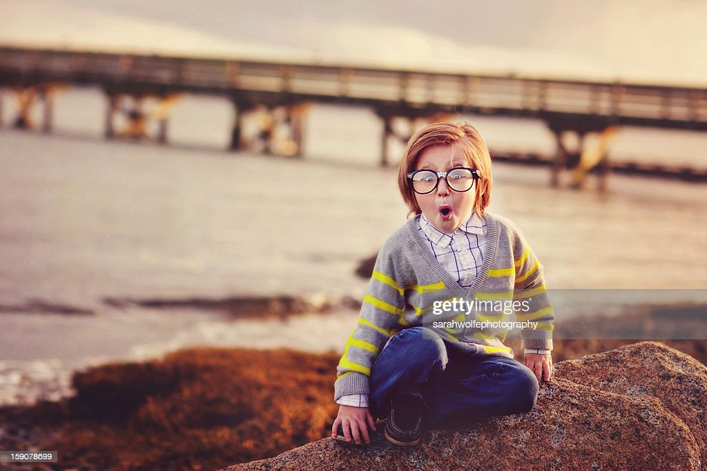 boy dressed in nerdy clothes, making a funny face : Stock Photo