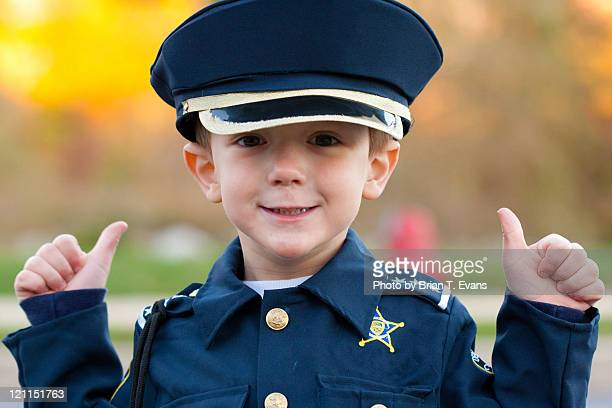 Boy dressed in police costume