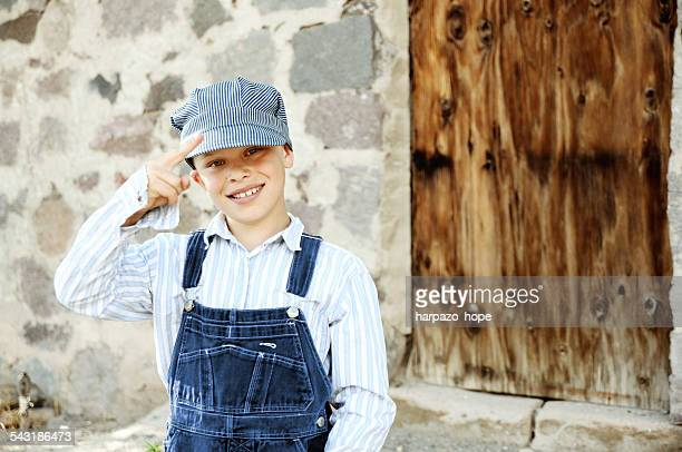 Boy dressed up as a train engineer
