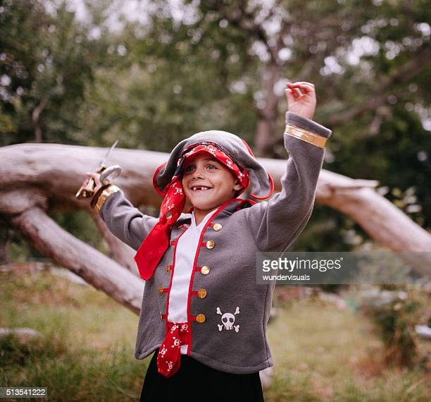 Boy dressed up as pirate excited with toothy smile