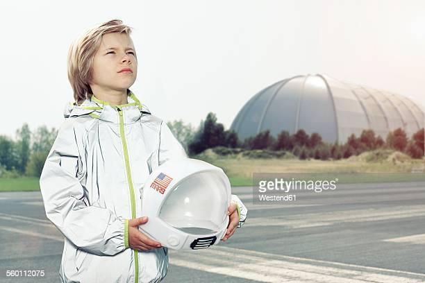 Boy dressed up as spaceman looking up
