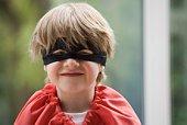 Boy dressed up as superhero