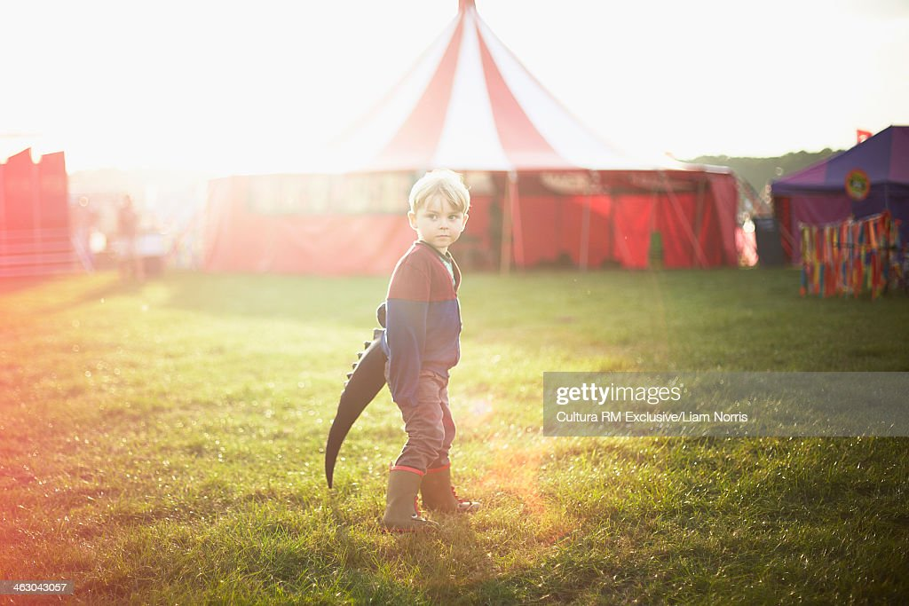 Boy dressed up at funfair : Stock Photo