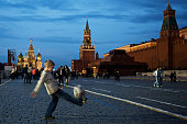 A boy dribbles a ball on Red Square on the eve of the Champions League Final between Manchester United and Chelsea May 20 2008 in Moscow Russia