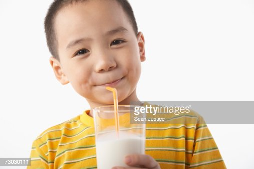 Boy (5-7) drinking milk : Stock Photo