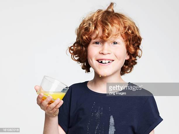 Boy drinking orange juice
