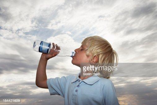 Boy drinking water : Stock Photo