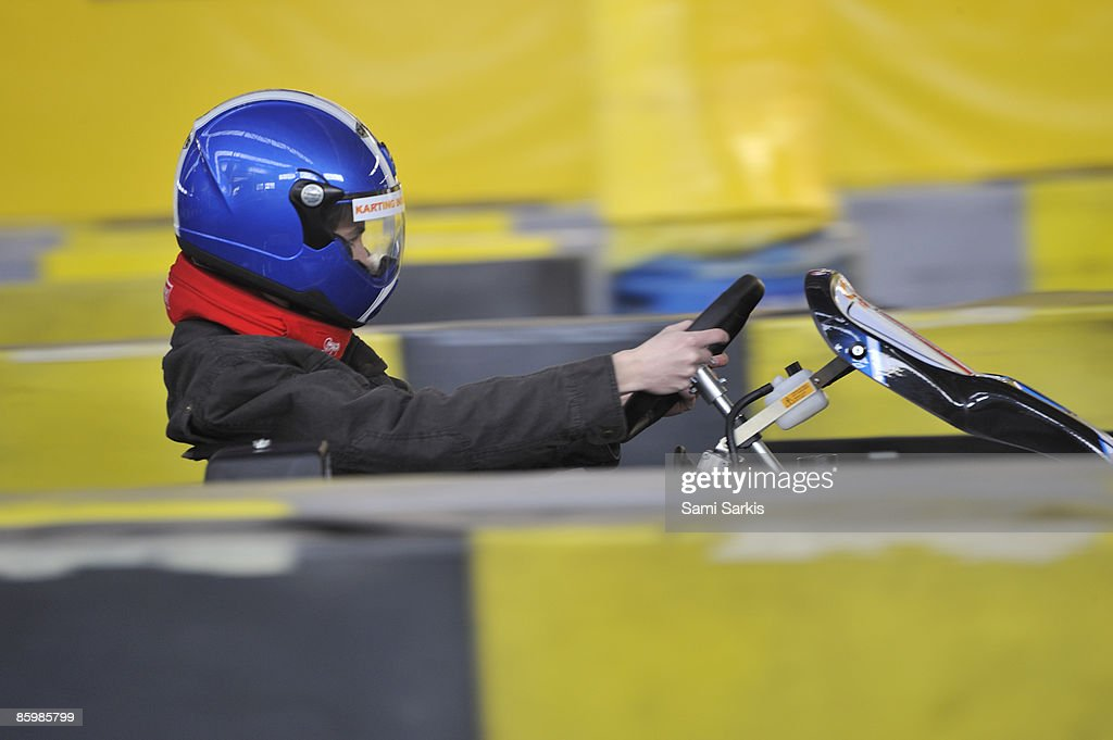 Boy (15) driving a go-cart on a race track : Stock Photo