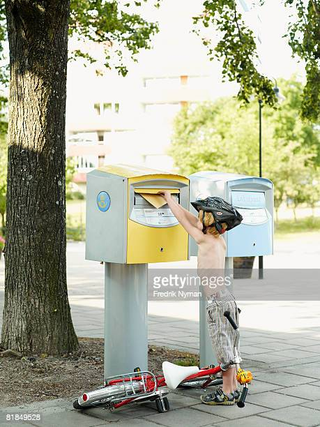 A boy dropping a letter into a box Sweden.