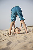 Boy drops his head on the beach in Dubai
