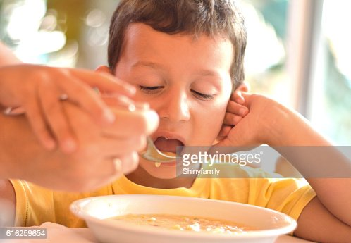 Boy Eating a Soup : Stock Photo