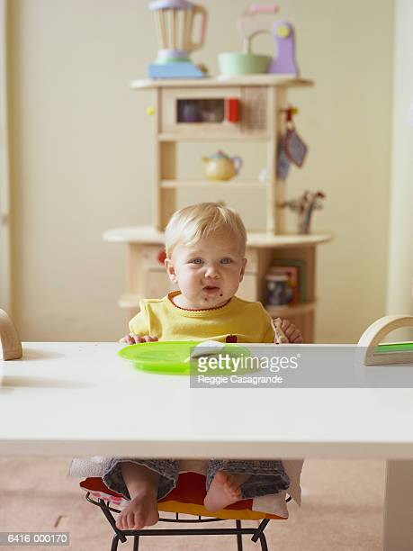 Boy Eating at Table
