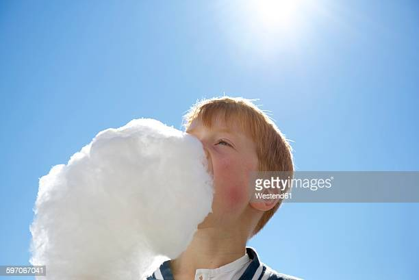 Boy eating candyfloss