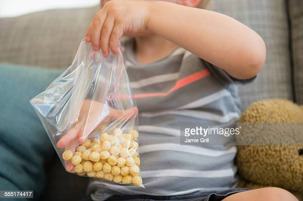 Boy (2-3) eating cereals