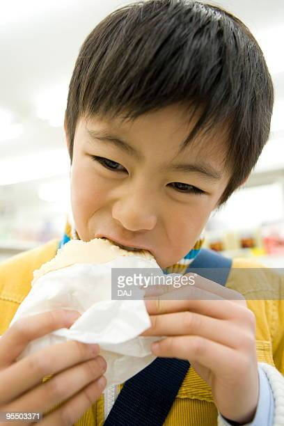 Boy eating Chinese steamed bun