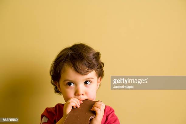 Boy eating chocolate bar