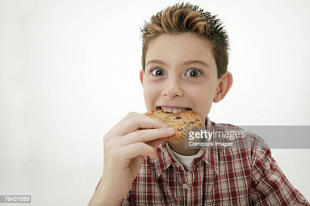 Boy eating cookie