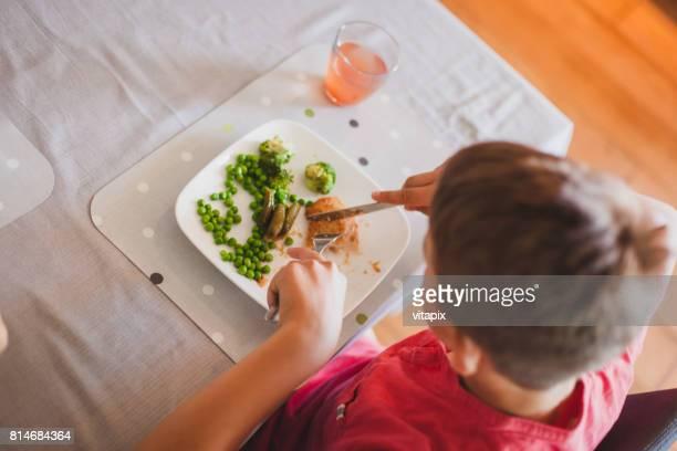 Boy Eating Dinner