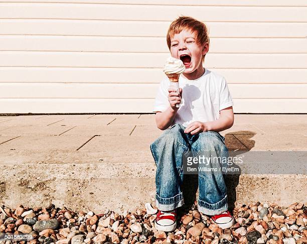 Boy eating ice cream outdoors