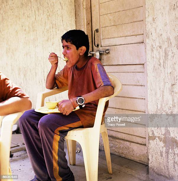 Boy eating, India