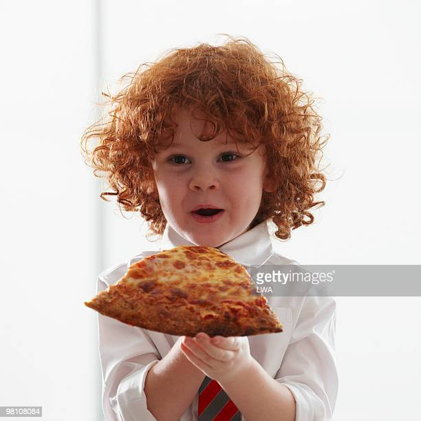 Boy Eating Large Slice of Pizza