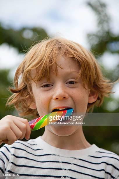 Boy eating lollipop