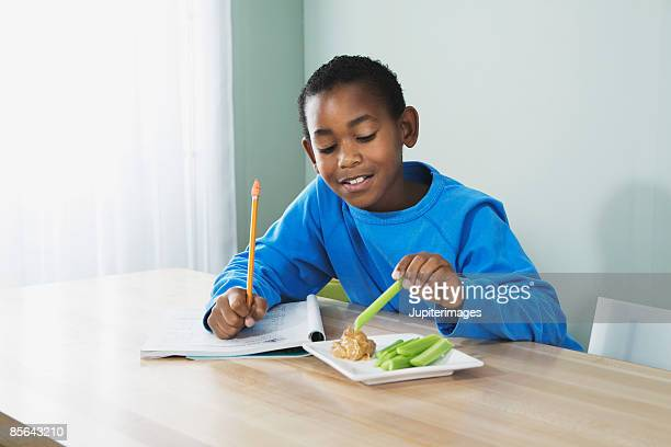 Boy eating peanut butter and celery